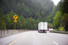 Two semi trucks with trailers moving towards each other at the t Royalty Free Stock Photography