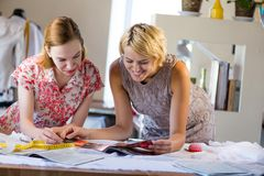 Two sempstress at work Royalty Free Stock Photo