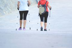 Two senior active females practicing some nordic walking in the city. Urban activity concept and empty copy space for Editor`s text Stock Photo