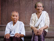Two senior asian women looking at camera Stock Photo