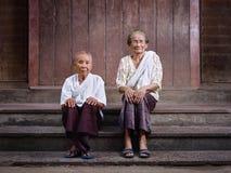 Two senior asian women looking at camera Stock Photos