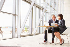 Two senior business colleagues at meeting in modern interior Royalty Free Stock Photos
