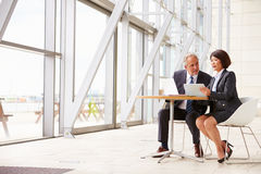 Two senior business colleagues at meeting in modern interior Stock Photography