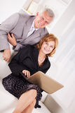 Two Senior business person. Working on laptop Stock Image
