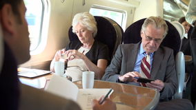 Two Senior Businesspeople Commuting On Train stock video