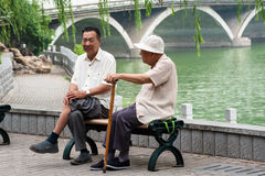 Two senior Chinese men chatting Royalty Free Stock Photo