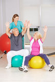 Two senior citizens doing sports in physiotherapy Stock Photo