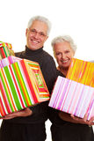Two senior citizens with gifts Stock Photos