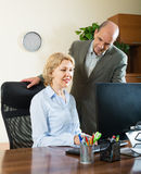 Two senior colleagues in office Stock Photography