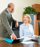 Two senior colleagues in office Stock Image