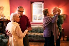Two senior couple dancing and enjoy together at home royalty free stock photos