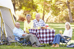 Two Senior Couples Enjoying Camping Holiday Stock Photos