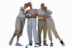 two senior couples holding golf clubs, cut out Royalty Free Stock Images