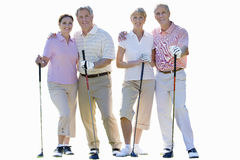 Two senior couples holding golf clubs, cut out Stock Image