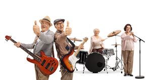 Free Two Senior Guitarist Showing Thumbs Up, A Lady Drummer And A Female Singer In A Music Band Stock Photos - 174795833