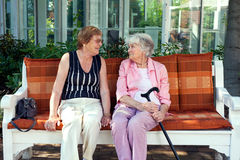 Two senior ladies enjoying a relaxing chat. Stock Photos