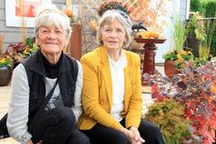 Two senior ladies seated on a patio Royalty Free Stock Photos