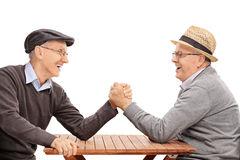 Two senior man having an arm wrestle competition Stock Photography
