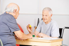 Two senior men in nursing home talking Royalty Free Stock Images