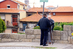 Two senior men on old street in Porto, Portugal Stock Image