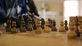 Two senior men playing chess. In the room stock video footage