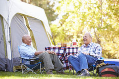 Two Senior Men Relaxing On Camping Holiday Stock Images