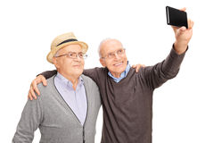 Two senior men taking a selfie with phone Royalty Free Stock Photo
