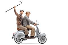 Two senior men on a vintage scooter, one holding a cane up. Full length shot of two senior men on a vintage scooter, one holding a cane up isolated on white stock image