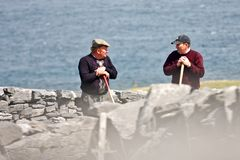 Two peasants talking, Inisheer, Ireland. Two senior peasants talking on the farmland in Inis Oirr, Aran Island, Ireland Royalty Free Stock Photography