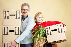 Two senior people carrying packing Stock Image