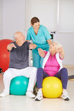 Two senior people doing fitness training in physiotherapy. With physiotherapist Stock Photo