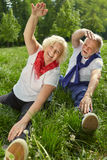 Two senior people doing gymnastics in nature Royalty Free Stock Images