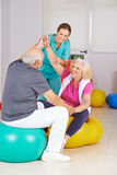 Two senior people doing physiotherapy in nursing home Stock Image