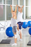 Two senior people exercising in gym Stock Images