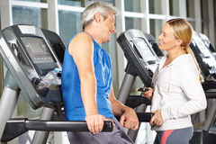 Two senior people in fitness center talking Royalty Free Stock Photo