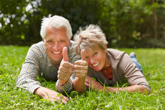 Two senior people holding thumbs up Stock Photo