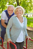 Two senior people on keep fit trail Royalty Free Stock Images