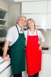 Two senior people in kitchen Royalty Free Stock Photo