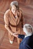 Two senior people making handshake Stock Photography