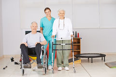Two senior people with nurse in nursing home Stock Photo