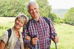 Two senior people smiling in summer royalty free stock images