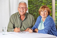 Two senior people solving riddles Royalty Free Stock Images