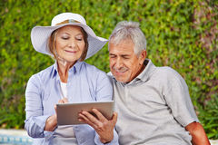 Two senior people with tablet computer Royalty Free Stock Photos