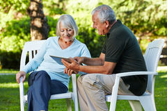 Two senior people with tablet PC royalty free stock photos