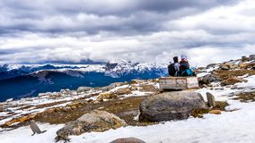 Two senior women enjoying the view on top of The Whistlers mountain in Jasper National Park. Two senior women enjoying the view of snow covered peaks of the Stock Photo