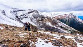 Two senior women enjoying the view on top of The Whistlers mountain in Jasper National Park. In the Canadian Rockies Stock Photo