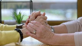 Two senior women holding hands. Ladies at the table. Everything will be fine stock footage