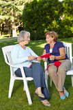 Two senior women knitting Royalty Free Stock Image