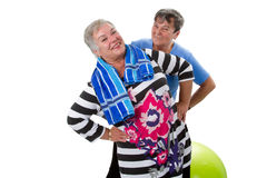 Two senior women making fitness exercises Royalty Free Stock Image
