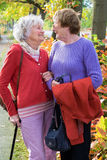 Two Senior Women Smiling to Each Other. Stock Images
